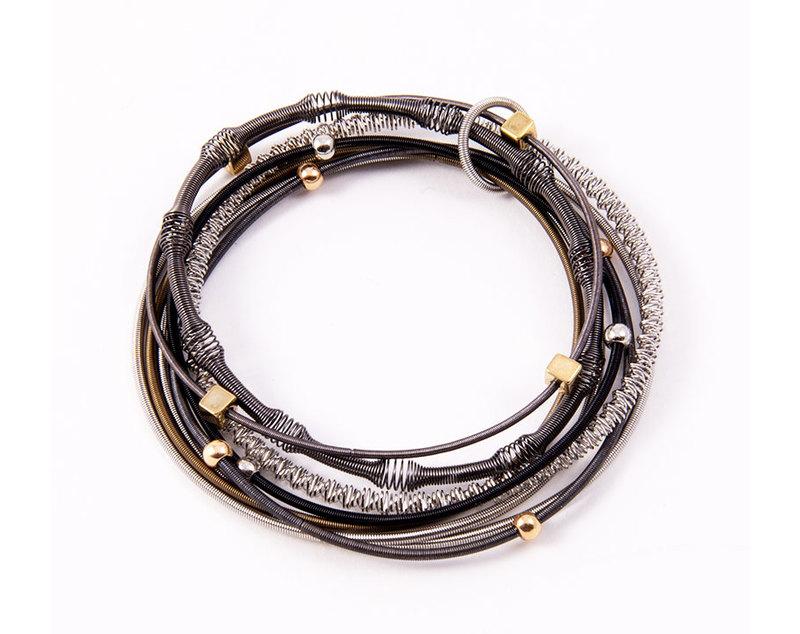 Multi strand piano wire bracelet